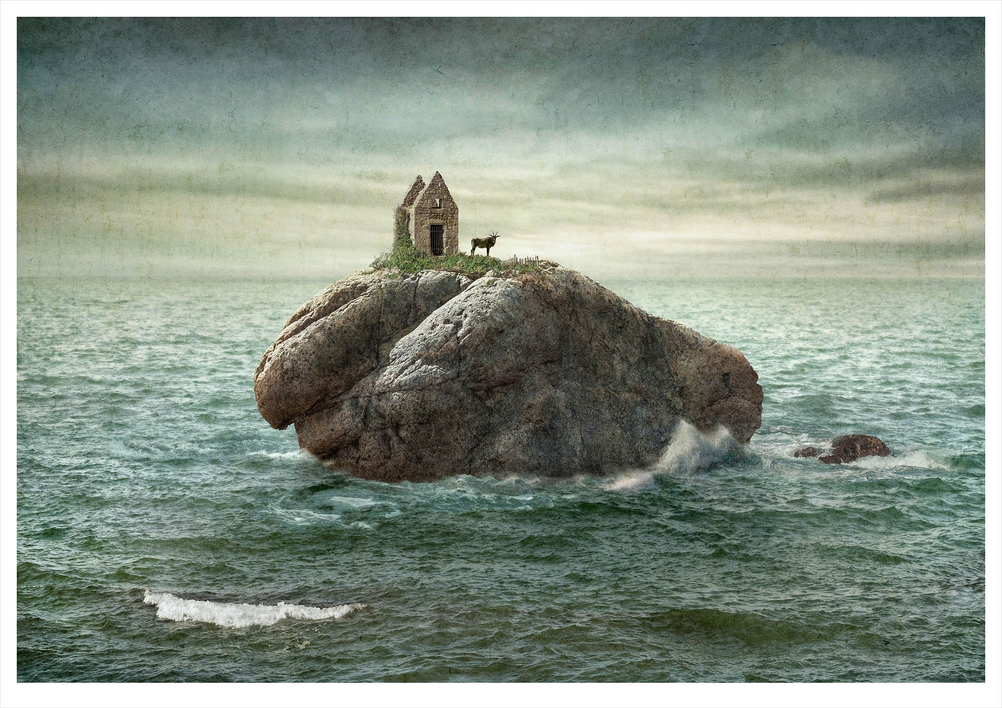 Solitary small island in ocean with ramshackle stone building and horned antelope looking to camera