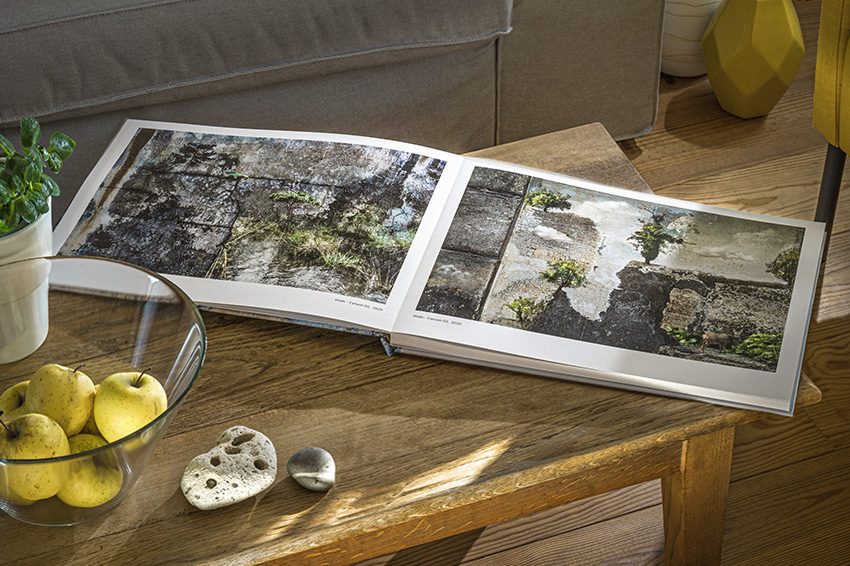 Double page spread of 'Everythings a Story' book on a coffee table